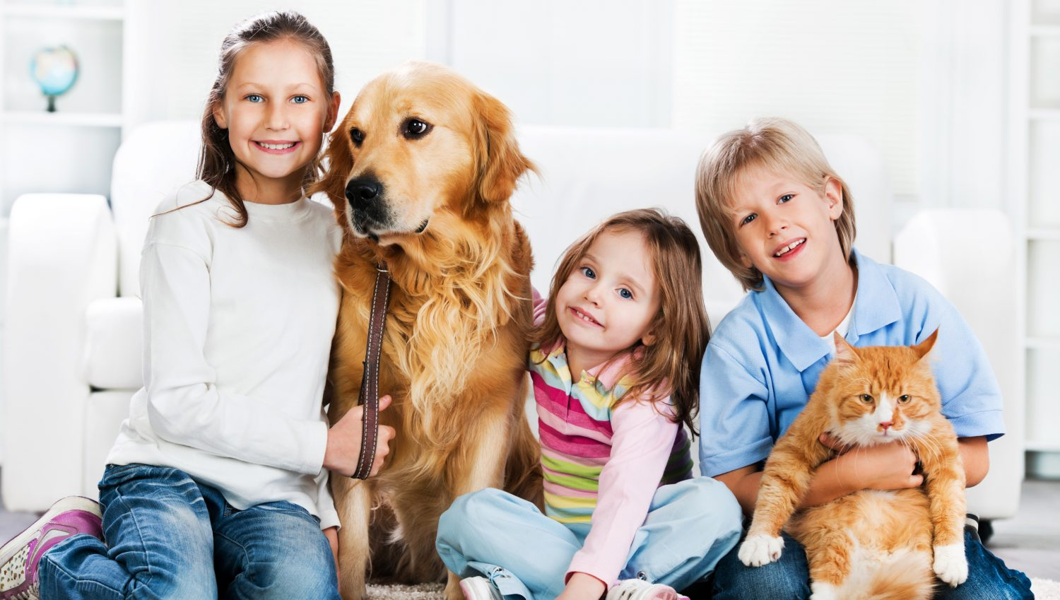 cropped-children-with-animals-sitting-on-the-carpet.jpg